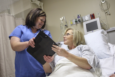 nurse reviewing chart with patient